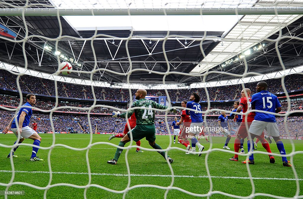 Andy Carroll of Liverpool (C) scores their second goal as goalkeeper Tim Howard of Everton looks on during the FA Cup with Budweiser Semi Final match between Liverpool and Everton at Wembley Stadium on April 14, 2012 in London, England.