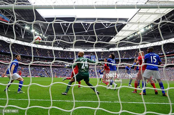 Andy Carroll of Liverpool scores their second goal as goalkeeper Tim Howard of Everton looks on during the FA Cup with Budweiser Semi Final match...
