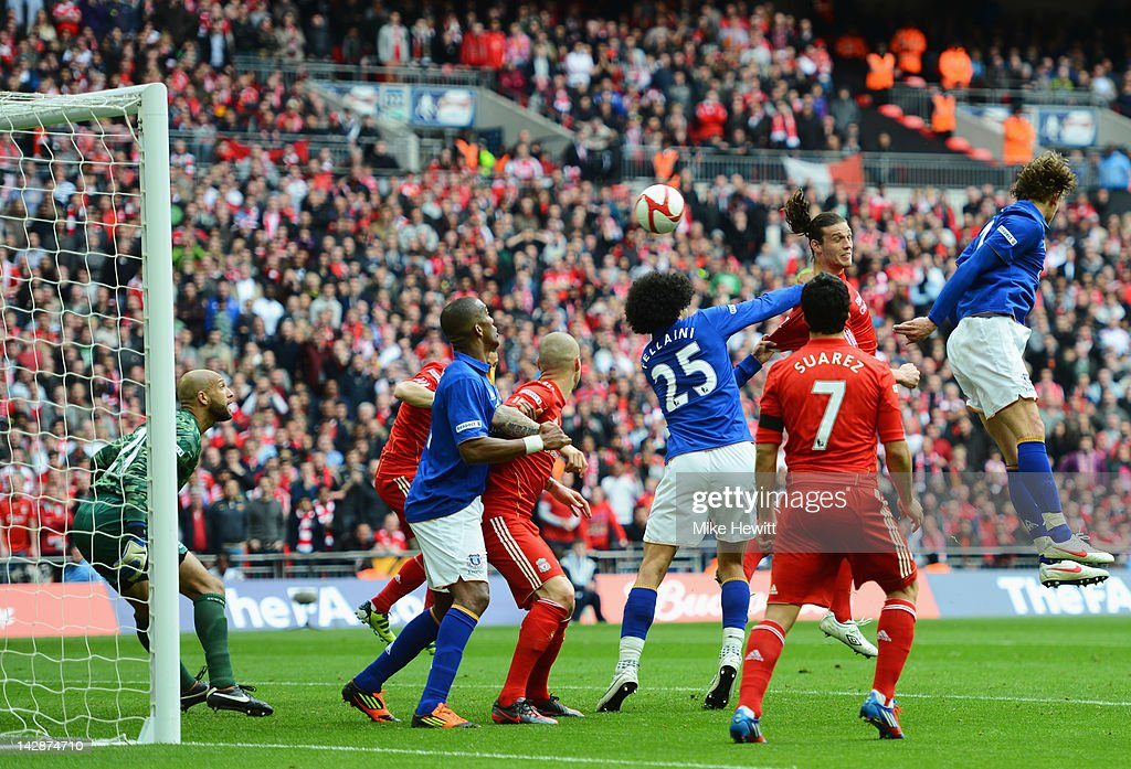 Andy Carroll of Liverpool (2R) scores their second goal during the FA Cup with Budweiser Semi Final match between Liverpool and Everton at Wembley Stadium on April 14, 2012 in London, England.