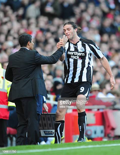 Andy Carroll of Newcastle celebrates with manager Chris Hughton after scoring during the Barclays Premier League match between Arsenal and Newcastle...
