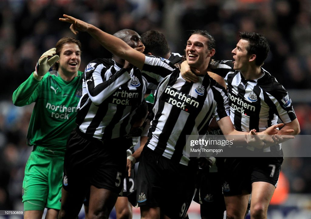 <a gi-track='captionPersonalityLinkClicked' href=/galleries/search?phrase=Andy+Carroll+-+Soccer+Player&family=editorial&specificpeople=1449090 ng-click='$event.stopPropagation()'>Andy Carroll</a> of Newcastle United celebrates scoring his team's third goal with his team mates during the Barclays Premier League match between Newcastle United and Liverpool at St James' Park on December 11, 2010 in Newcastle, England.