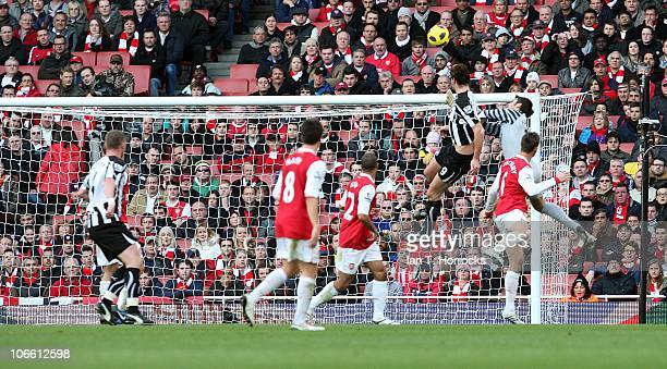 Andy Carroll of Newcastle United scores his team's first goal during the Barclays Premier League match between Arsenal and Newcastle United at the...