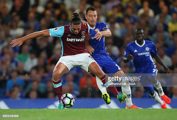 Andy Carroll of West Ham and John Terry of Chelsea during the Premier League match between Chelsea and West Ham United at Stamford Bridge on August...