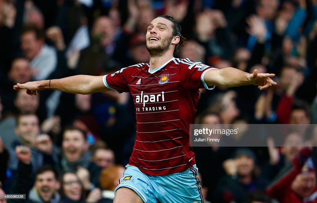 Andy Carroll of West Ham celebrates scoring their first goal during the Barclays Premier League match between West Ham United and Swansea City at Boleyn Ground on December 7, 2014 in London, England.