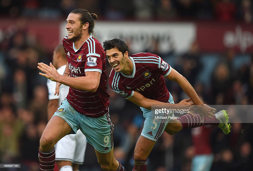 Andy Carroll of West Ham celebrates scoring their second goal with James Tomkins of West Ham during the Barclays Premier League match between West Ham United and Swansea City at Boleyn Ground on December 7, 2014 in London, England.