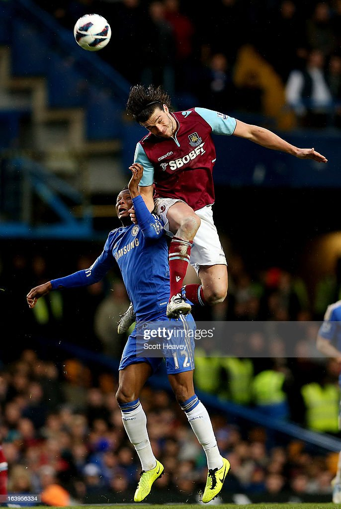 Andy Carroll of West Ham (R) challenges John Obi Mikel of Chelsea during the Barclays Premier League match between Chelsea and West Ham United at Stamford Bridge on March 17, 2013 in London, England.