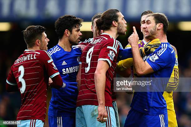 Andy Carroll of West Ham clashes with Branislav Ivanovic of Chelsea during the Barclays Premier League match between Chelsea and West Ham United at...