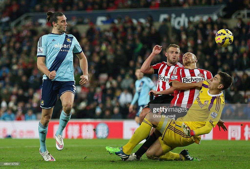 Andy Carroll of West Ham directs a header wide of goal during the Barclays Premier League match between Sunderland and West Ham United at Stadium of Light on December 13, 2014 in Sunderland, England.