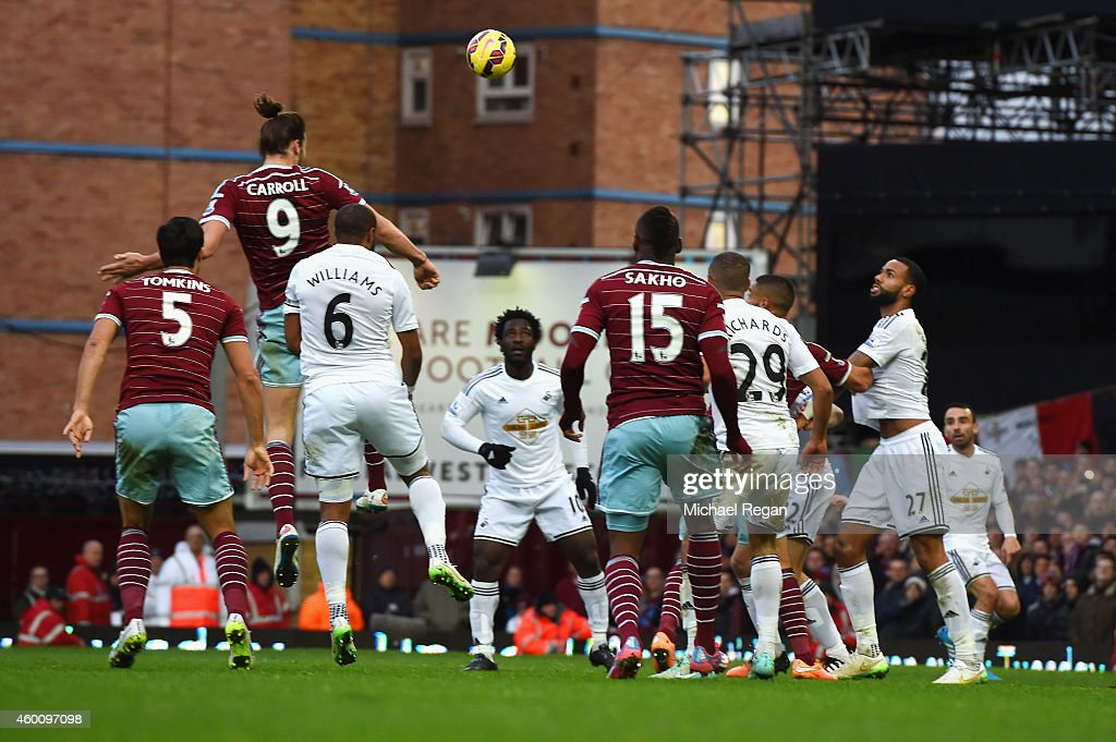 Andy Carroll of West Ham heads in their second goal during the Barclays Premier League match between West Ham United and Swansea City at Boleyn Ground on December 7, 2014 in London, England.