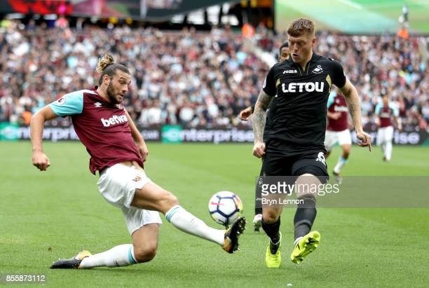 Andy Carroll of West Ham United and Alfie Mawson of Swansea City compete for the ball during the Premier League match between West Ham United and...