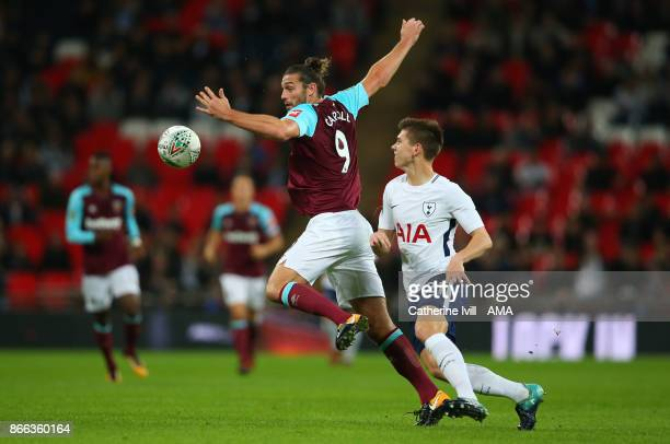 Andy Carroll of West Ham United and Juan Foyth of Tottenham Hotspur during the Carabao Cup Fourth Round match between Tottenham Hotspur and West Ham...
