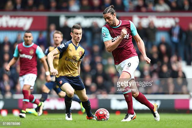 Andy Carroll of West Ham United and Laurent Koscielny of Arsenal compete for the ball during the Barclays Premier League match between West Ham...