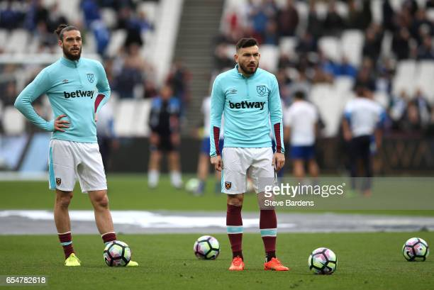 Andy Carroll of West Ham United and Robert Snodgrass of West Ham United look on during the warm up prior to the Premier League match between West Ham...