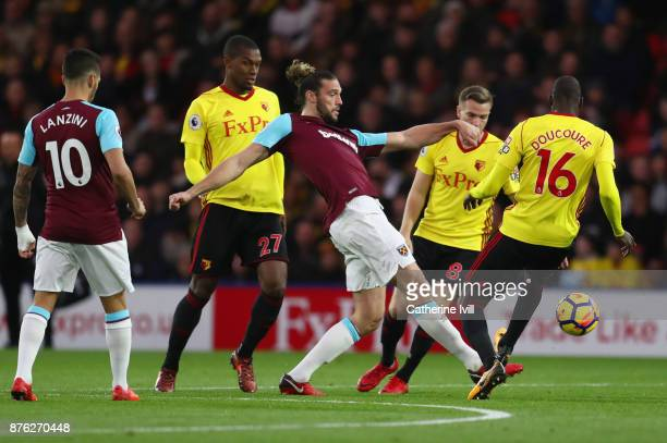 Andy Carroll of West Ham United battled with Abdoulaye Doucoure of Watford during the Premier League match between Watford and West Ham United at...