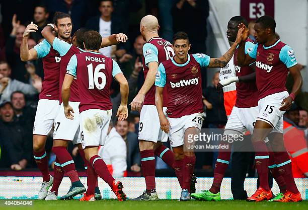 Andy Carroll of West Ham United celeberates scoring his team's second goal with his team mates during the Barclays Premier League match between West...