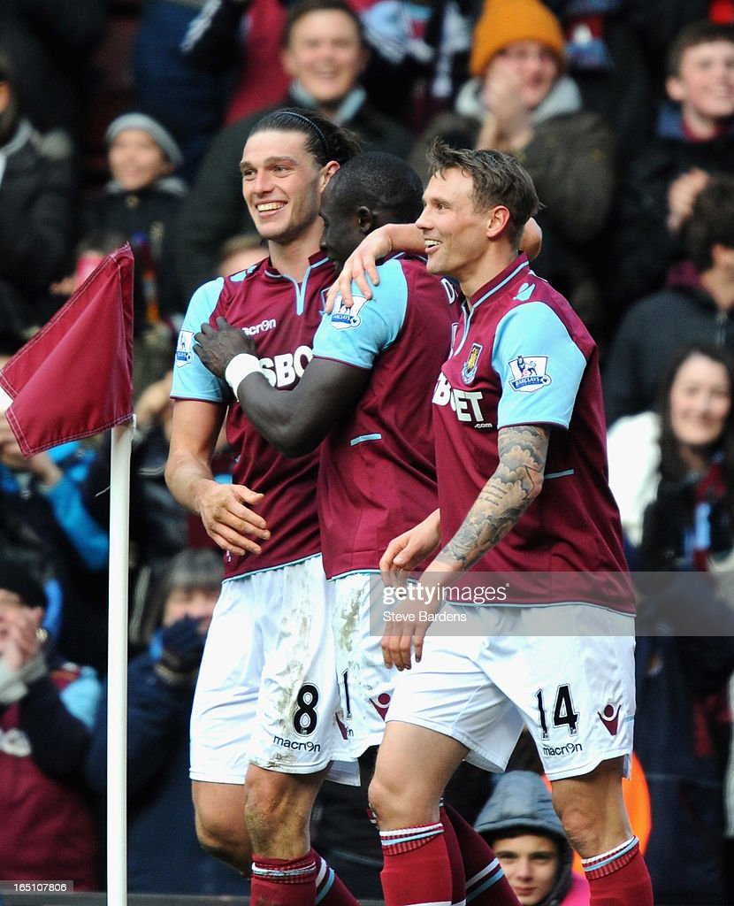 <a gi-track='captionPersonalityLinkClicked' href=/galleries/search?phrase=Andy+Carroll+-+Soccer+Player&family=editorial&specificpeople=1449090 ng-click='$event.stopPropagation()'>Andy Carroll</a> of West Ham United (L) celebrates scoring his second goal and his team's third with teammates Mohamed Diame (C) and Matthew Taylor during the Barclays Premier League match between West Ham United and West Bromwich Albion at the Boleyn Ground on March 30, 2013 in London, England.