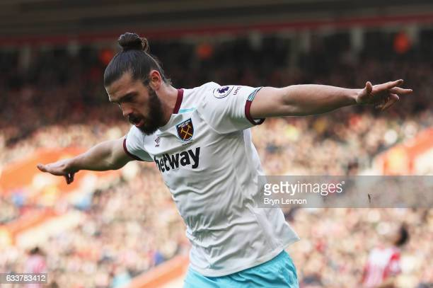Andy Carroll of West Ham United celebrates scoring his sides first goal during the Premier League match between Southampton and West Ham United at St...