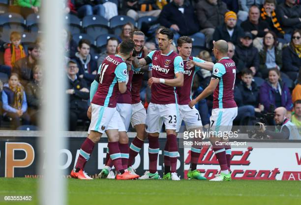 Andy Carroll of West Ham United celebrates scoring his sides first goal during the Premier League match between Hull City and West Ham United at KCOM...