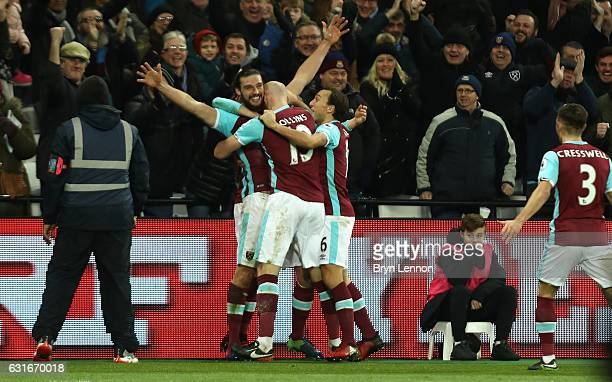 Andy Carroll of West Ham United celebrates scoring his sides second goal with his West Ham United team mates during the Premier League match between...