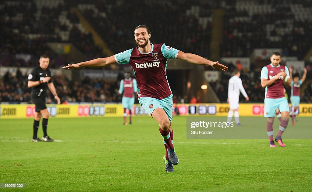 Andy Carroll of West Ham United celebrates scoring his team's fourth goal during the Premier League match between Swansea City and West Ham United at Liberty Stadium on December 26, 2016 in Swansea, Wales.