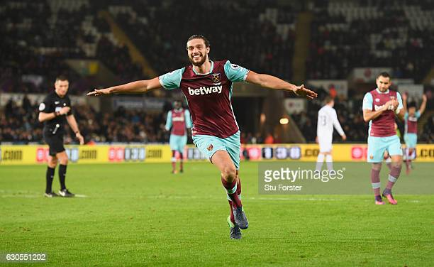 Andy Carroll of West Ham United celebrates scoring his team's fourth goal during the Premier League match between Swansea City and West Ham United at...