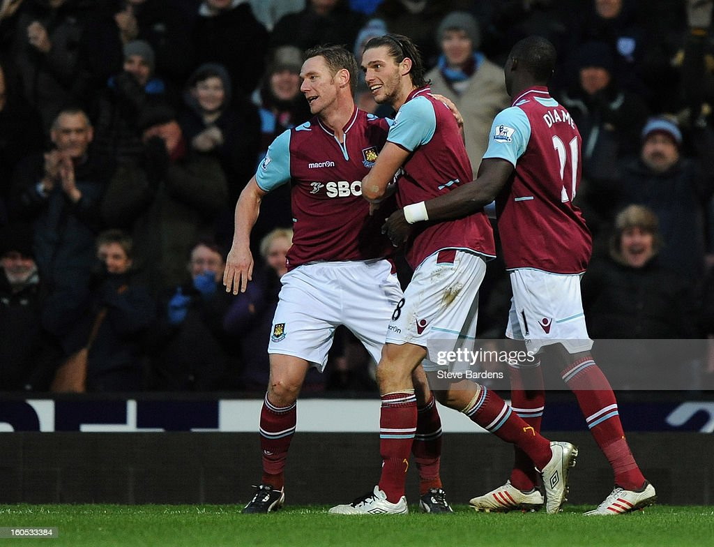 Andy Carroll (C) of West Ham United celebrates scoring the first and only goal of the game with Kevin Nolan (L) and Mohamed Diame during the Barclays Premier League match between West Ham United and Swansea at the Boleyn Ground on February 2, 2013 in London, England.