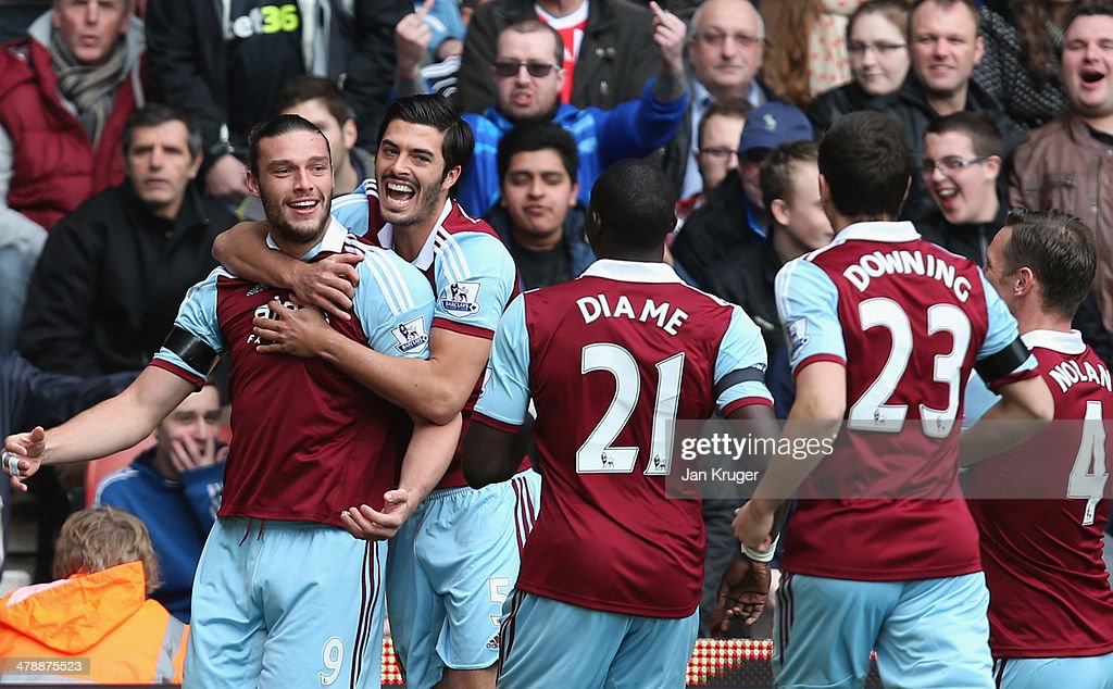 Andy Carroll of West Ham United (L) celebrates with team mates as he scores their first goal during the Barclays Premier League match between Stoke City and West Ham United at Britannia Stadium on March 15, 2014 in Stoke on Trent, England.