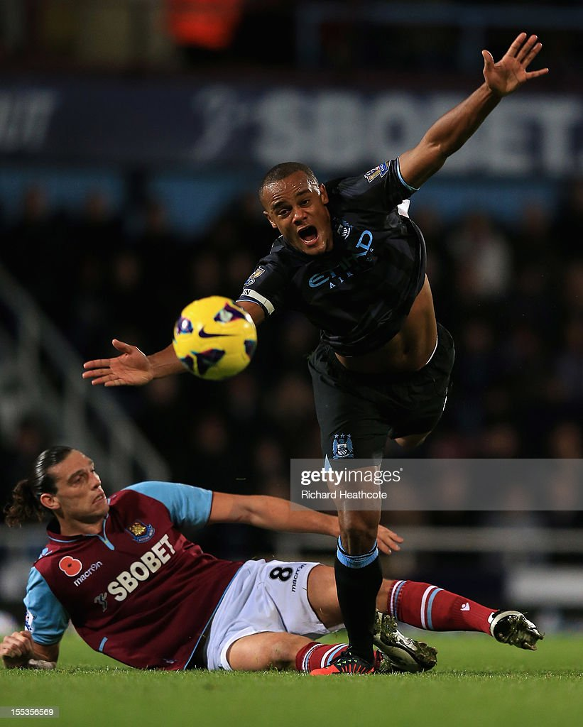 <a gi-track='captionPersonalityLinkClicked' href=/galleries/search?phrase=Andy+Carroll+-+Soccer+Player&family=editorial&specificpeople=1449090 ng-click='$event.stopPropagation()'>Andy Carroll</a> of West Ham United challenges <a gi-track='captionPersonalityLinkClicked' href=/galleries/search?phrase=Vincent+Kompany&family=editorial&specificpeople=504694 ng-click='$event.stopPropagation()'>Vincent Kompany</a> of Manchester City during the Barclays Premier League match between West Ham United and Manchester City at the Boleyn Ground on November 3, 2012 in London, England.