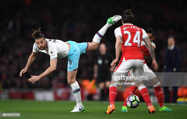 Andy Carroll of West Ham United heads the ball during the Premier League match between Arsenal and West Ham United at the Emirates Stadium on April 5...
