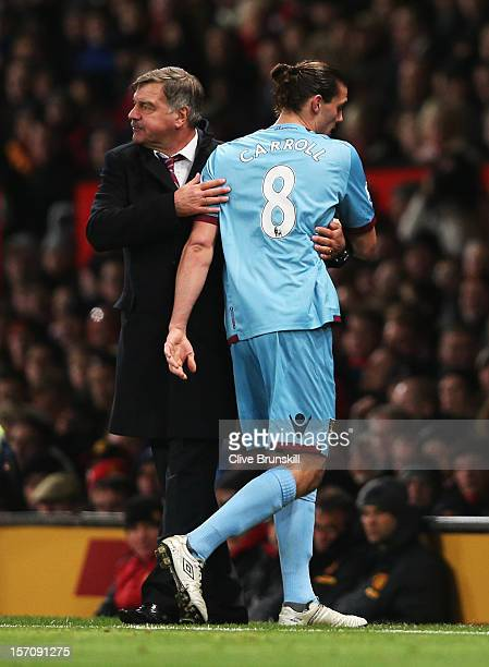 Andy Carroll of West Ham United is embraced by Sam Allardyce manager of West Ham United as he is substituted during the Barclays Premier League match...