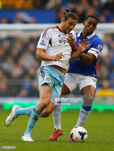 Andy Carroll of West Ham United is tackled by Sylvain Distin of Everton during the Barclays Premier League match between Everton and West Ham United...