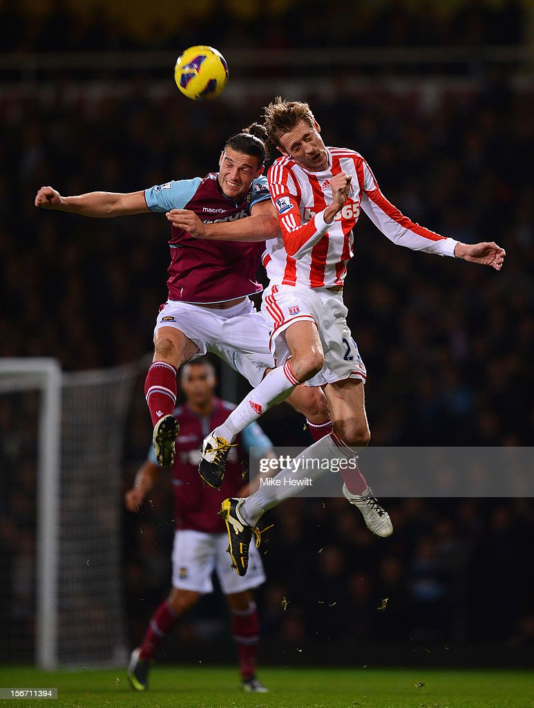 <a gi-track='captionPersonalityLinkClicked' href=/galleries/search?phrase=Andy+Carroll+-+Soccer+Player&family=editorial&specificpeople=1449090 ng-click='$event.stopPropagation()'>Andy Carroll</a> of West Ham United jumps for a header with <a gi-track='captionPersonalityLinkClicked' href=/galleries/search?phrase=Peter+Crouch&family=editorial&specificpeople=210764 ng-click='$event.stopPropagation()'>Peter Crouch</a> of Stoke City during the Barclays Premier League match between West Ham United and Stoke City at the Boleyn Ground on November 19, 2012 in London, England.