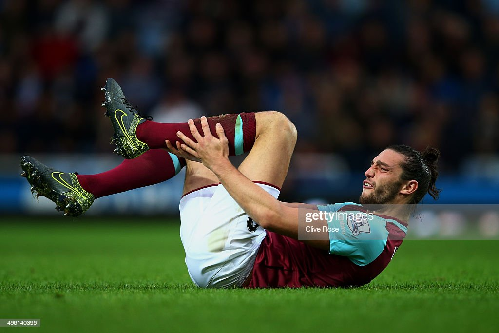 Andy Carroll of West Ham United lies injured during the Barclays Premier League match between West Ham United and Everton at Boleyn Ground on November 7, 2015 in London, England.