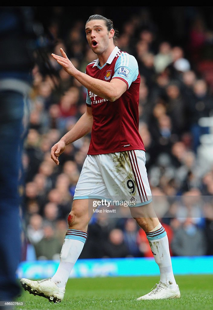 Andy Carroll of West Ham United reacts as he is sent off after a clash with Chico Flores of Swansea City (not pictured) during the Barclays Premier League match between West Ham United and Swansea City at Boleyn Ground on February 1, 2014 in London, England.
