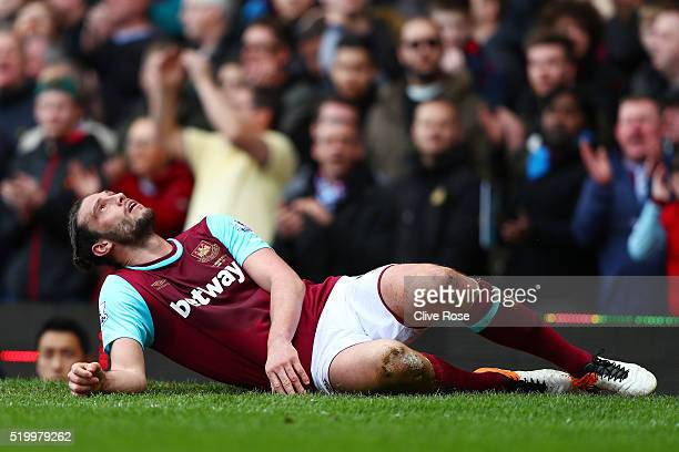 Andy Carroll of West Ham United reacts during the Barclays Premier League match between West Ham United and Arsenal at the Boleyn Ground on April 9...