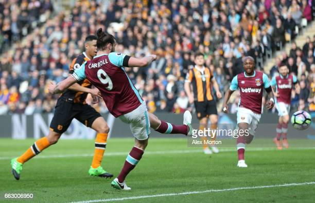 Andy Carroll of West Ham United scores his sides first goal during the Premier League match between Hull City and West Ham United at KCOM Stadium on...