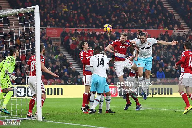 Andy Carroll of West Ham United scores his sides first goal with a header during the Premier League match between Middlesbrough and West Ham United...