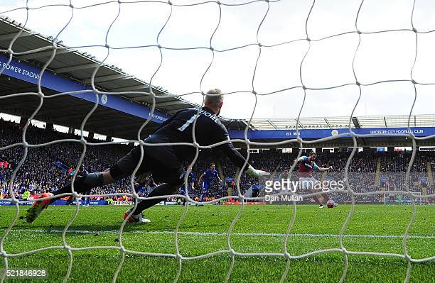 Andy Carroll of West Ham United scores his team's first goal of the game from the penalty spot during the Barclays Premier League match between...