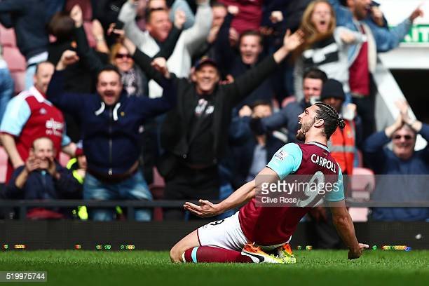 Andy Carroll of West Ham United scores his team's second goal during the Barclays Premier League match between West Ham United and Arsenal at the...