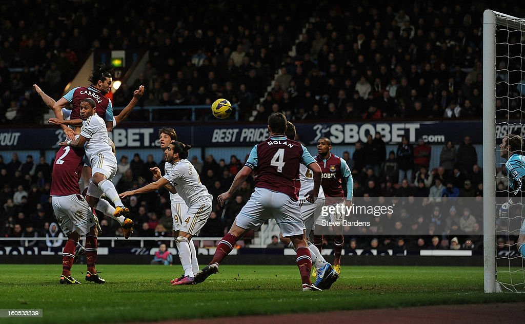 Andy Carroll of West Ham United scores the first and only goal of the game with a header during the Barclays Premier League match between West Ham United and Swansea at the Boleyn Ground on February 2, 2013 in London, England.
