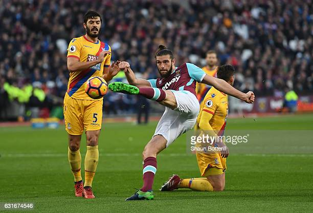 Andy Carroll of West Ham United volleys towards goal during the Premier League match between West Ham United and Crystal Palace at London Stadium on...
