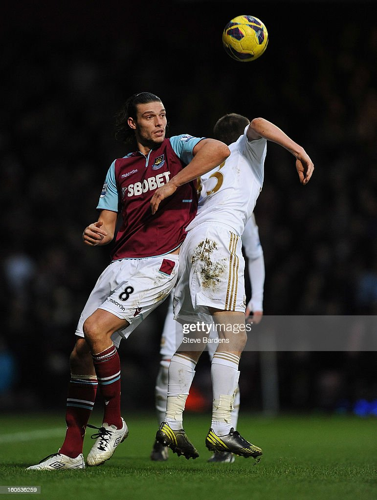 <a gi-track='captionPersonalityLinkClicked' href=/galleries/search?phrase=Andy+Carroll+-+Soccer+Player&family=editorial&specificpeople=1449090 ng-click='$event.stopPropagation()'>Andy Carroll</a> of West Ham United wins a header from Ben Davies of Swansea City during the Barclays Premier League match between West Ham United and Swansea at the Boleyn Ground on February 2, 2013 in London, England.