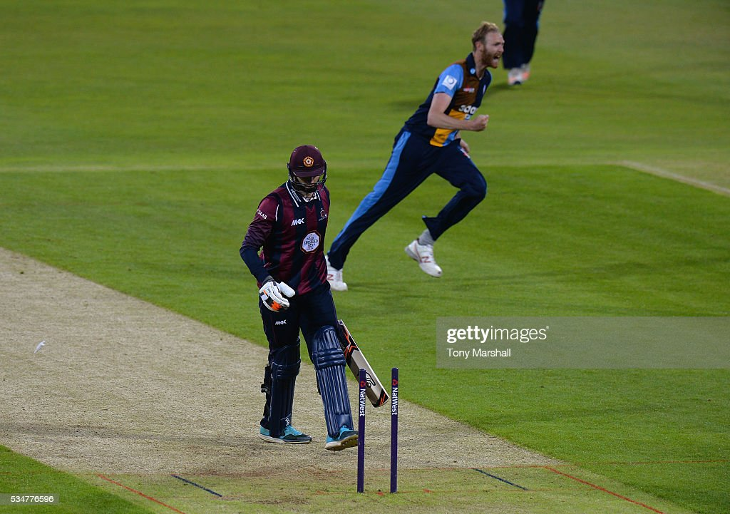 Andy Carter of Derbyshire celebrates taking the wicket of Rob Keogh of Northamptonshire hits a six during the NatWest T20 Blast match between Northamptonshire and Derbyshire at The County Ground on May 27, 2016 in Northampton, England.