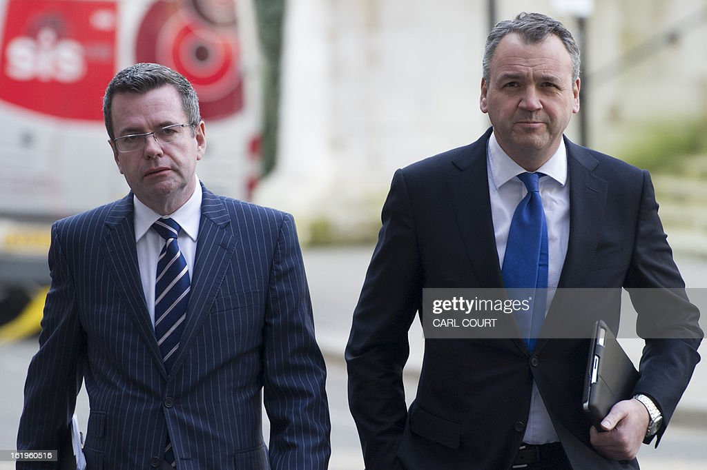Andy Clarke (R), chief executive of British supermarket Asda and Corporate Affairs Director Paul Kelly (L), arrive for a meeting with British Environment Secretary, Owen Paterson (not pictured) and other food retailers, in central London on February 18, 2013, to establish what is being done to restore consumer confidence in the wake of the horse meat scandal. AFP PHOTO/CARL COURT