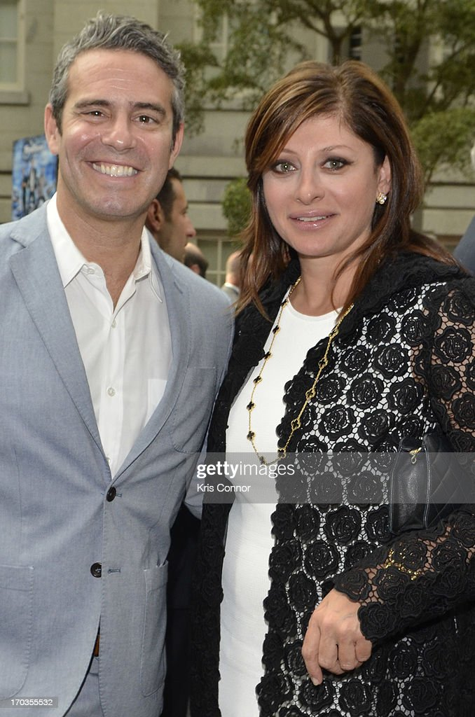 Andy Cohen and Maria Bartiromo pose for a photo during a NCTA reception hosted by A+E Networks at Smithsonian American Art Museum & National Portrait Gallery on June 11, 2013 in Washington, DC.