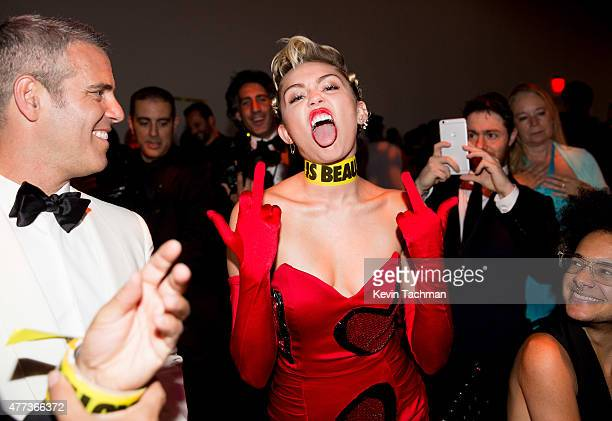 Andy Cohen and Miley Cyrus attend the 2015 amfAR Inspiration Gala New York at Spring Studios on June 16 2015 in New York City