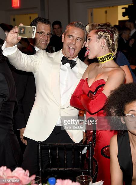 Andy Cohen and Miley Cyrus take a selfie during the amfAR Inspiration Gala New York with FIJI Water at Spring Studios on June 16 2015 in New York City