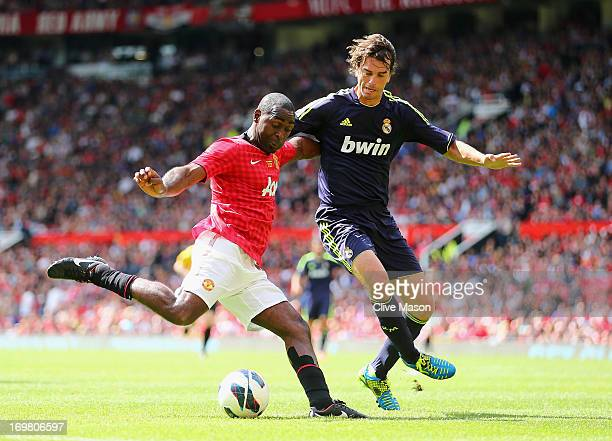 Andy Cole of Manchester United holds off a challenge from Francisco Pavon of Real Madrid during the charity match between Manchester United Legends...