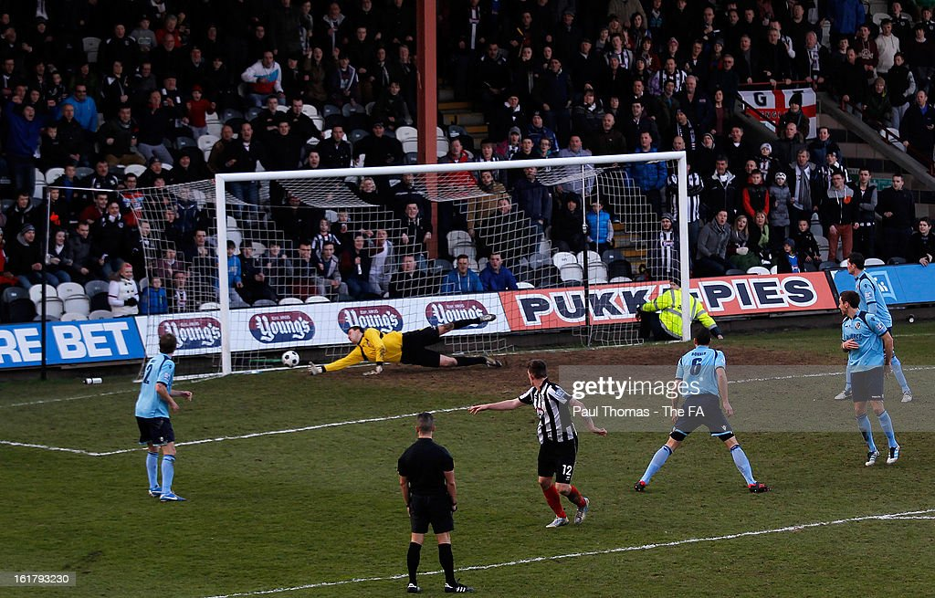 Andy Cook (C) of Grimsby scores their third goal during the FA Trophy semi final match between Grimsby Town v Dartford at Blundell Park on February 16, 2013 in Grimsby, England.