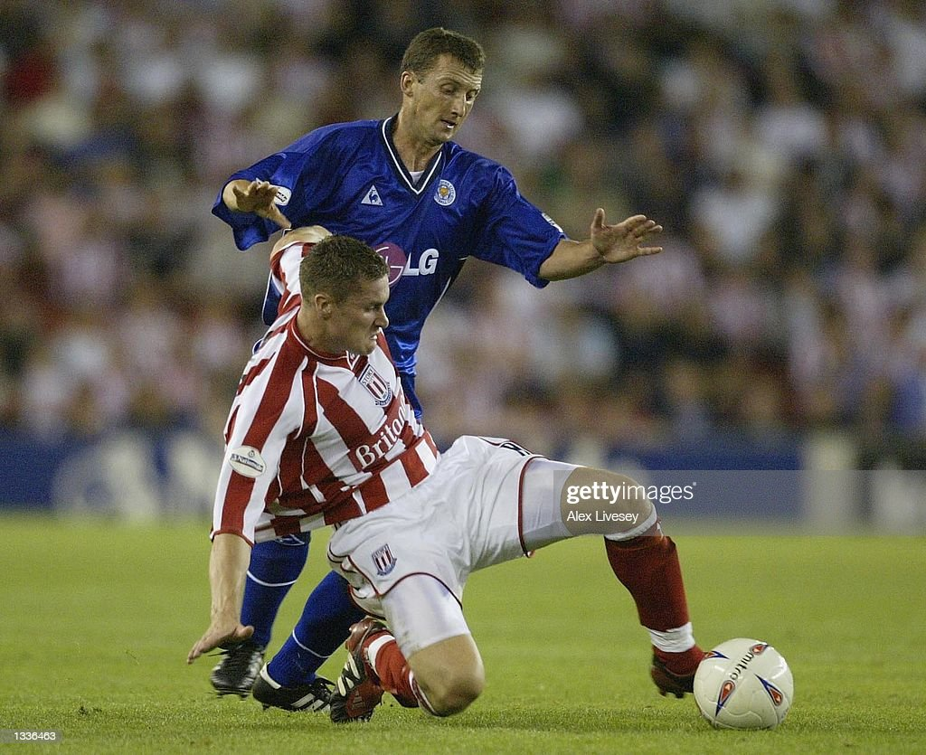 Andy Cooke of Stoke tackles Billy McKinlay of Leicester during the Nationwide League Division One match between Stoke City and Leicester City at the Britannia Stadium, Stoke on August 14, 2002.